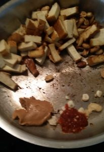 Adding in sambal oelek, garlic and peanut butter